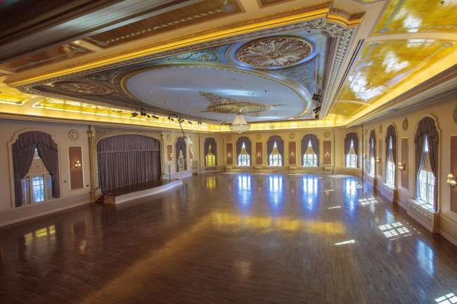 Gleaminag Ballroom dance floor with crystal chandelier and stage