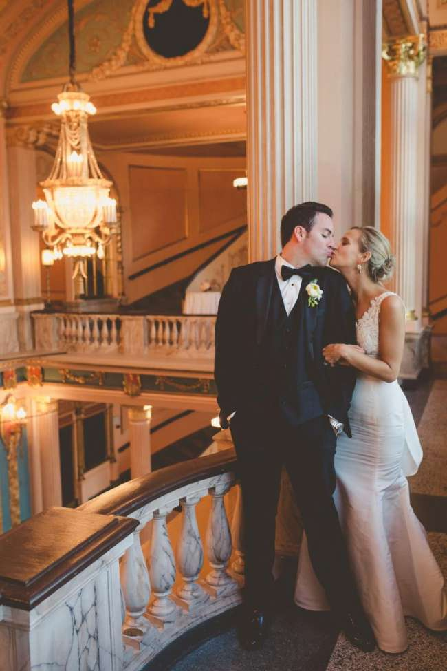 Wedding Couple Kissing in Morris Performing Arts Center Grand Lobby