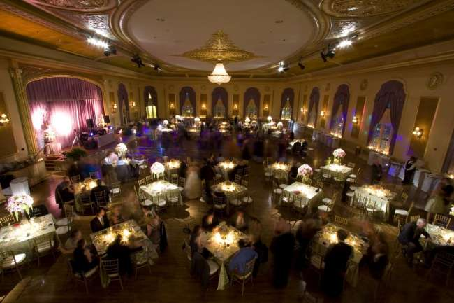 Reception square tables for 8 with dramatic lighting