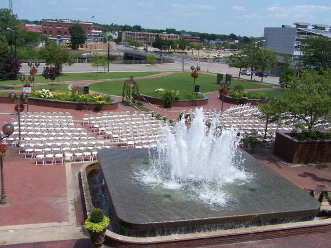 Outdoor wedding ceremony by fountain at Jon R. Hunt Plaza in front of Morris Performing Arts Center