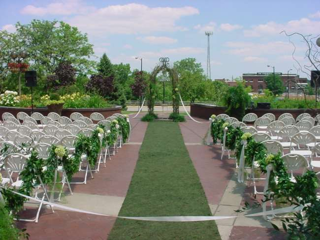Outdoor wedding ceremony at Jon R. Hunt Plaza in front of Morris Performing Arts Center