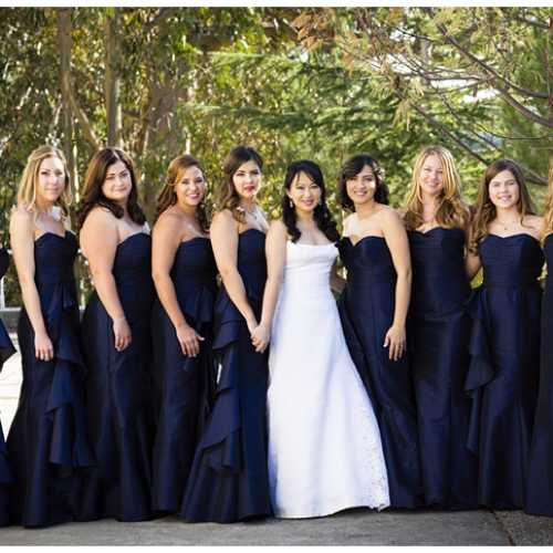 Bride With Bridesmaids in Floor-Length, Strapless Gowns