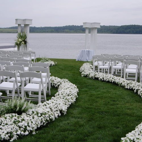 Aisle Lined With Flowers at Outdoor Ceremony