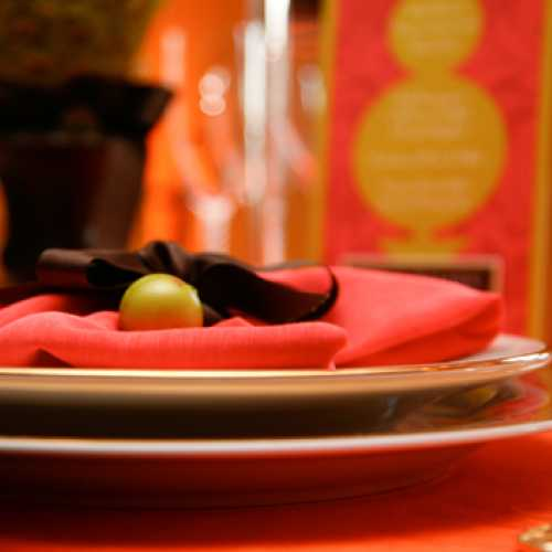 Coral and Gold Table Setting